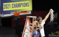 Stanford head coach Tara VanDerveer waves the net after defeating UCLA in an NCAA college basketball game in the Pac-12 women's tournament championship Sunday, March 7, 2021, in Las Vegas. (AP Photo/Isaac Brekken)