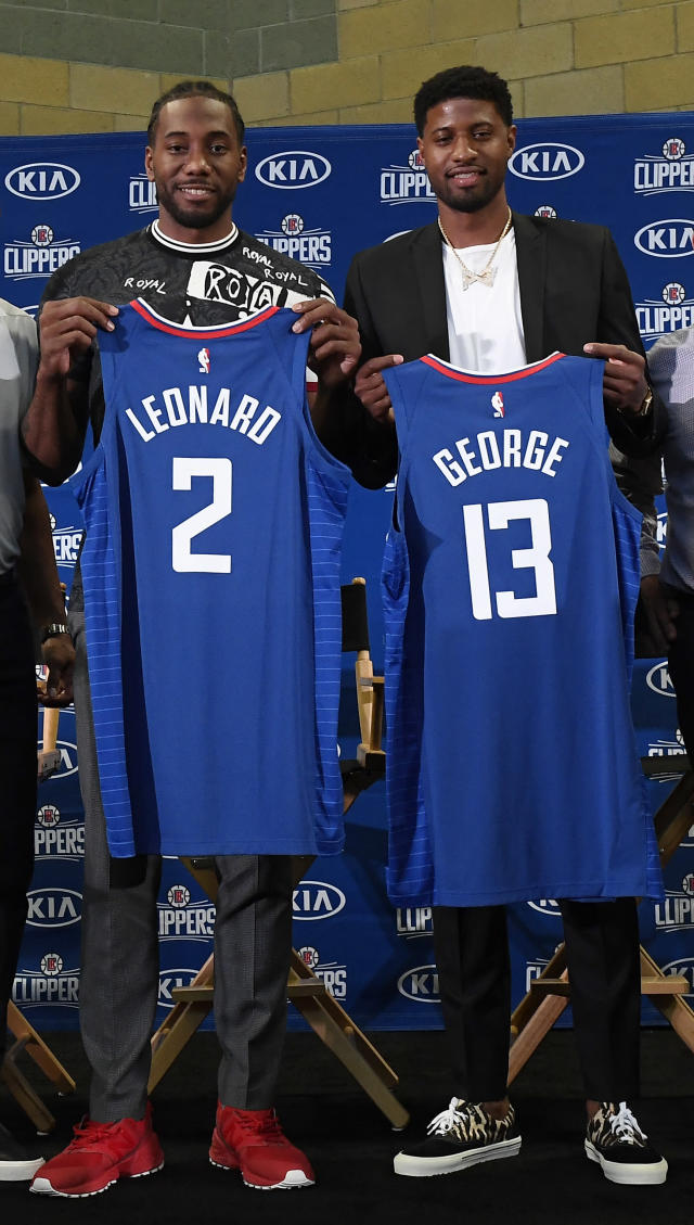 LOS ANGELES, CA - JULY 24: Kawhi Leonard and Paul George pose after a news conference where both players were introduced as new Los Angeles Clippers at Green Meadows Recreation Center on July 24, 2019 in Los Angeles, California. (Photo by Kevork Djansezian/Getty Images)