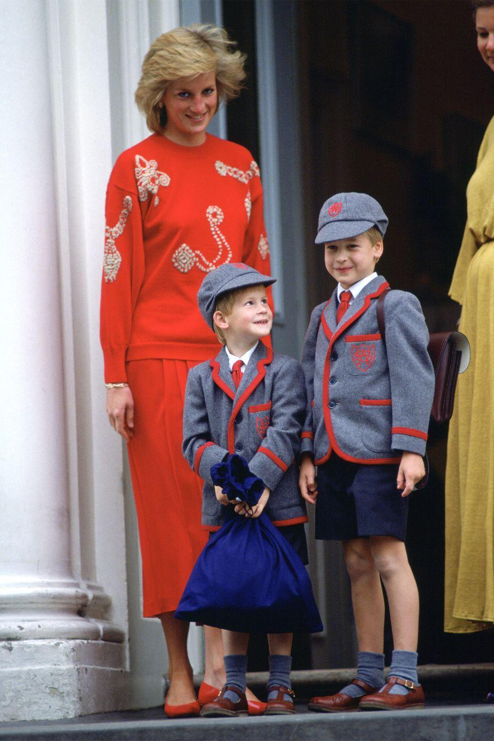 <p>Standing on the steps of Wetherby School for Prince Harry's first day of school with both Princes in matching uniforms. </p>