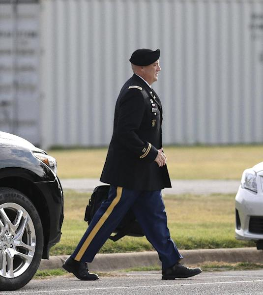 Military prosecutor U.S. Army Cols. Steve Henricks walks to the courthouse holding the court martial of Maj. Nidal Malik Hasan Friday, Aug. 23, 2013, in Fort Hood, Texas. Military jurors are deliberating for a verdict against Hasan, on trial for the 2009 shooting rampage at Fort Hood. (AP Photo/LM Otero)