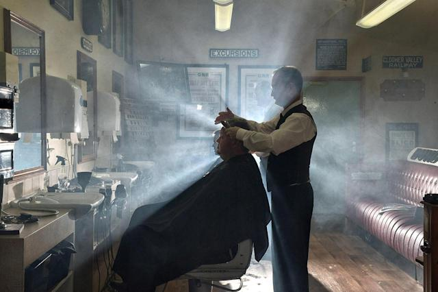 <p>A customer of the Headhunters Barber Shop and Railway Museum in Enniskillen, Northern Ireland gets a haircut from station master Nigel Johnston. </p>