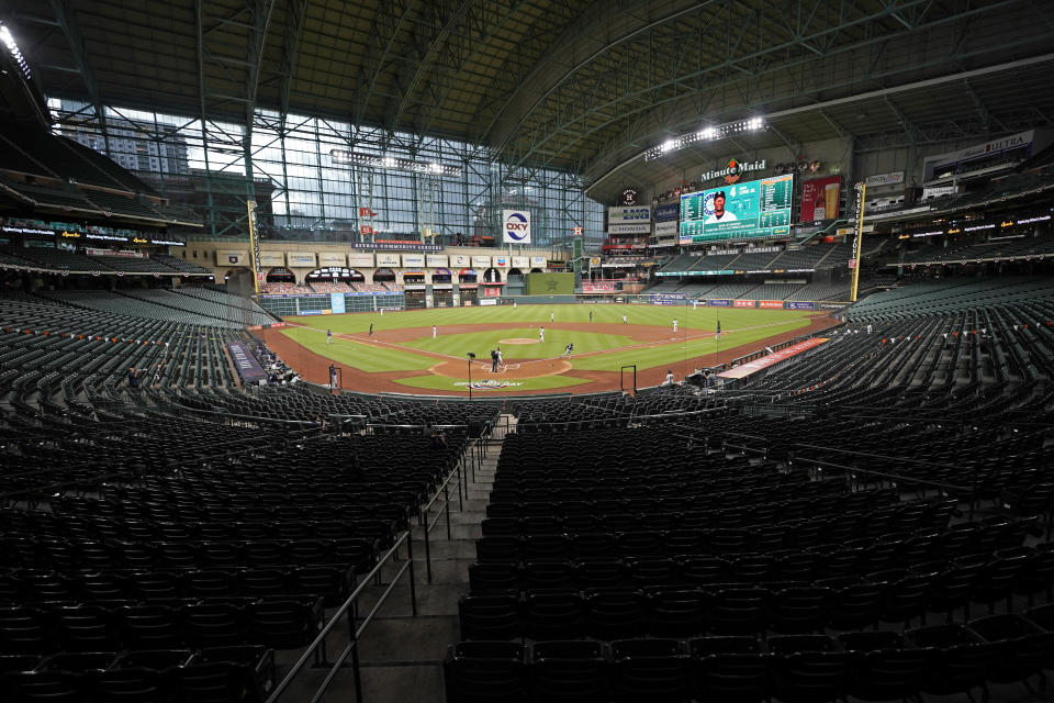 The Seattle Mariners play the Houston Astros in an empty Minute Maid Park during the first inning of a baseball game Friday, July 24, 2020, in Houston. (AP Photo/David J. Phillip)