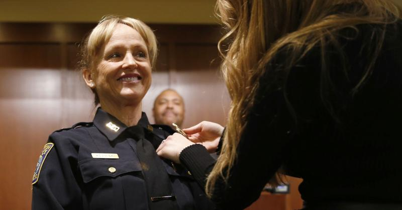 A Boston police captain is pinned by her daughter after being promoted.