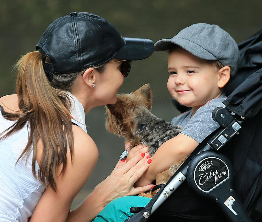 Orlando Bloom and Miranda Kerr's son Flynn kept a tight hold of his puppy, Frankie, while out with his model mom. The mother-son duo were strolling around in NYC's Central Park. (7/26/2013)