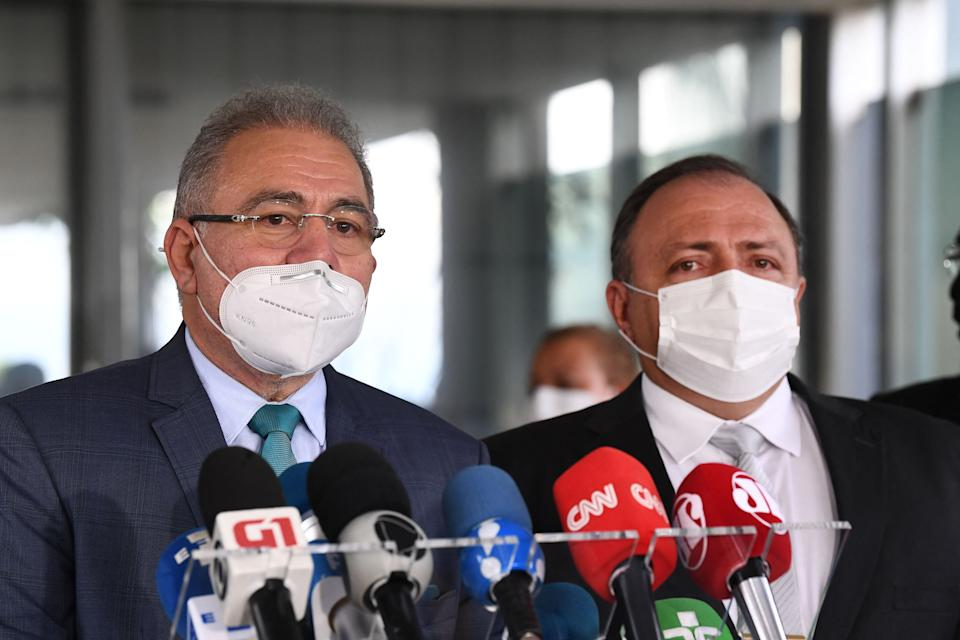 Doctor Marcelo Queiroga (L), appointed by Brazilian President Jair bolsonaro for Minister of Health, and current Minister Eduardo Pazuello talk to the press outside the ministry in Brasilia, on March 16, 2021. - Queiroga replaces the former Minister of Health Eduardo Pazuello at a time when the health system is on the verge of collapse due to the coronavirus pandemic that has already left nearly 280,000 dead. (Photo by EVARISTO SA / AFP) (Photo by EVARISTO SA/AFP via Getty Images)