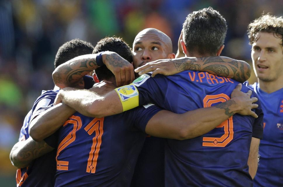 Dutch players celebrate after Netherlands' Memphis Depay scored his side's third goal during the group B World Cup soccer match between Australia and the Netherlands at the Estadio Beira-Rio in Porto Alegre, Brazil, Wednesday, June 18, 2014.   (AP Photo/Wong Maye-E)