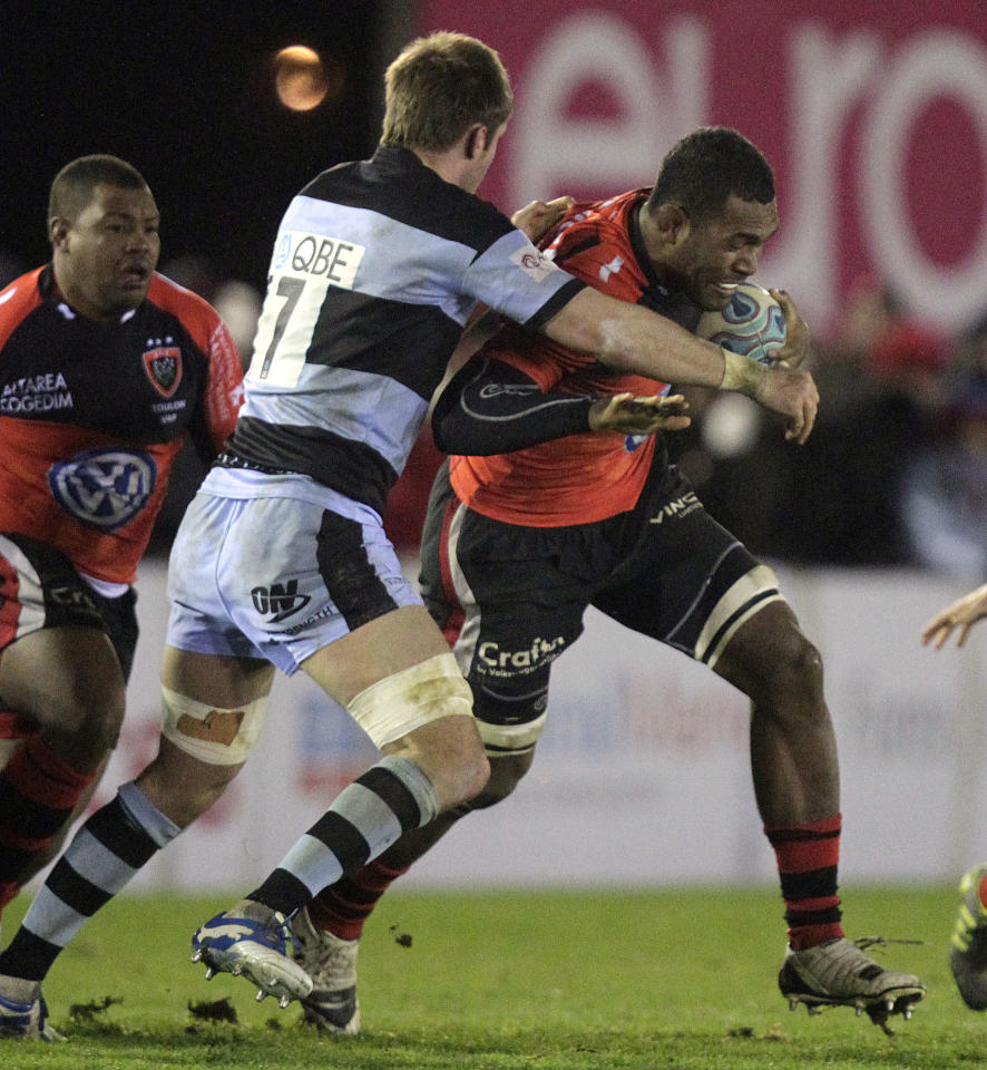 Newcastle Falcons' Will Welch (L) tackles Toulon's Seva Rokobaro (R) during a pool 2, European Challenge Cup rugby union match at Kingston Park, Newcastle upon Tyne, England, on December 08, 2011. AFP PHOTO/GRAHAM STUART (Photo credit should read GRAHAM STUART/AFP/Getty Images)