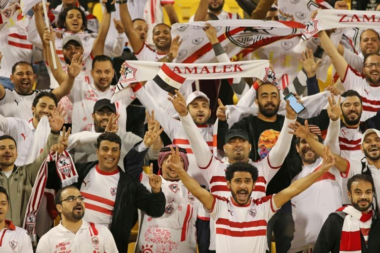 Zamalek fans watch their side's Super Cup clash against Esperance Sportive in Doha (AFP Photo/KARIM JAAFAR)