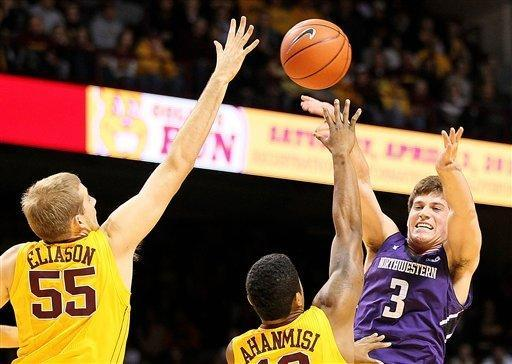 Northwestern guard Dave Sobolewski (3) passes out of pressure from Minnesota center Elliott Eliason (55) and Maverick Ahanmisi during the first half of an NCAA college basketball game, Sunday, Jan. 6, 2013, in Minneapolis. (AP Photo/Andy King)