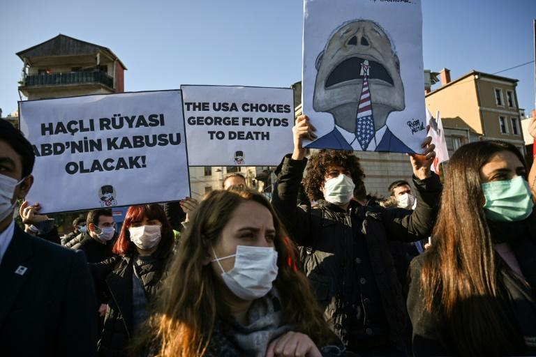 Members of Turkish Youth Union (TGB) chant anti-US slogans and hold placards