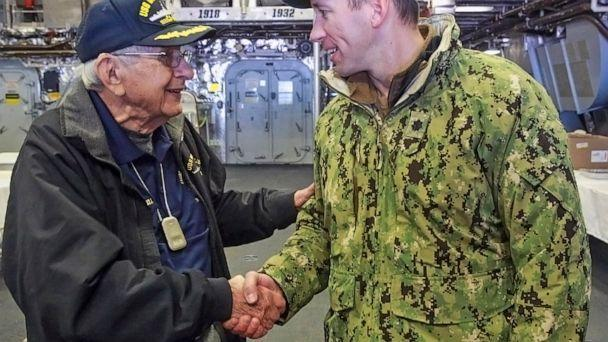 PHOTO: Sgt. Edgar Harrell, U.S. Navy (Ret.) shakes hands with Commander Colin Kane, soon to be commissioned as Captain of the USS Indianapolis, Oct. 24, 2019. (John J. Watkins/AP, FILE)