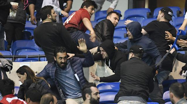 """<p>The start of Lyon and Besiktas' quarterfinal matchup in the UEFA Europa League was disrupted on Thursday by fighting, projectiles, and general chaos caused by fans at the Parc Olympique Lyonnais. </p><p>An tweet from Olympique Lyon's official account indicated that projectiles and fireworks launched from the upper level of the stadium forced fans on the lower levels out on to the field. Just over 30 minutes from the match's scheduled kickoff time, <a href=""""https://twitter.com/PedroPintoUEFA/status/852606443954032640"""" rel=""""nofollow noopener"""" target=""""_blank"""" data-ylk=""""slk:UEFA announced"""" class=""""link rapid-noclick-resp"""">UEFA announced</a> that the game would go on despite the disturbance. </p><p>Video from the scene shows fighting in the stands amongst fans. <a href=""""https://sg.news.yahoo.com/steward-hurt-violence-ahead-lyon-besiktas-185018557--sow.html"""" data-ylk=""""slk:AFP reports"""" class=""""link rapid-noclick-resp"""">AFP reports</a>, via a photographer on the ground, that a steward has been injured in the melee, which has reportedly been caused by fans of the Turkish side. </p><p>AFP also reports that rival fans clashed outside of the stadium before the game, with Besiktas fans smashing the glass door to the club store after being denied tickets to the match. </p><p>The clashes came just two days after another off-field incident disrupted a European game, with the attack on Borussia Dortmund's team bus delaying the start of the German side's Champions League tie against AS Monaco. </p>"""
