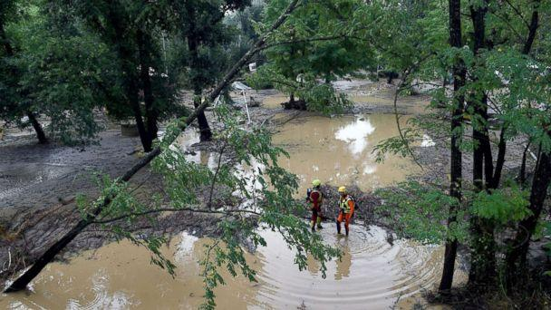 PHOTO: Rescuers stand in a flooded area of a camping as storms and heavy rains sweep across France, Aug. 9, 2018, in Saint-Julien-de-Peyrolas, southern France. (Boris Horvat/AFP/Getty Images)