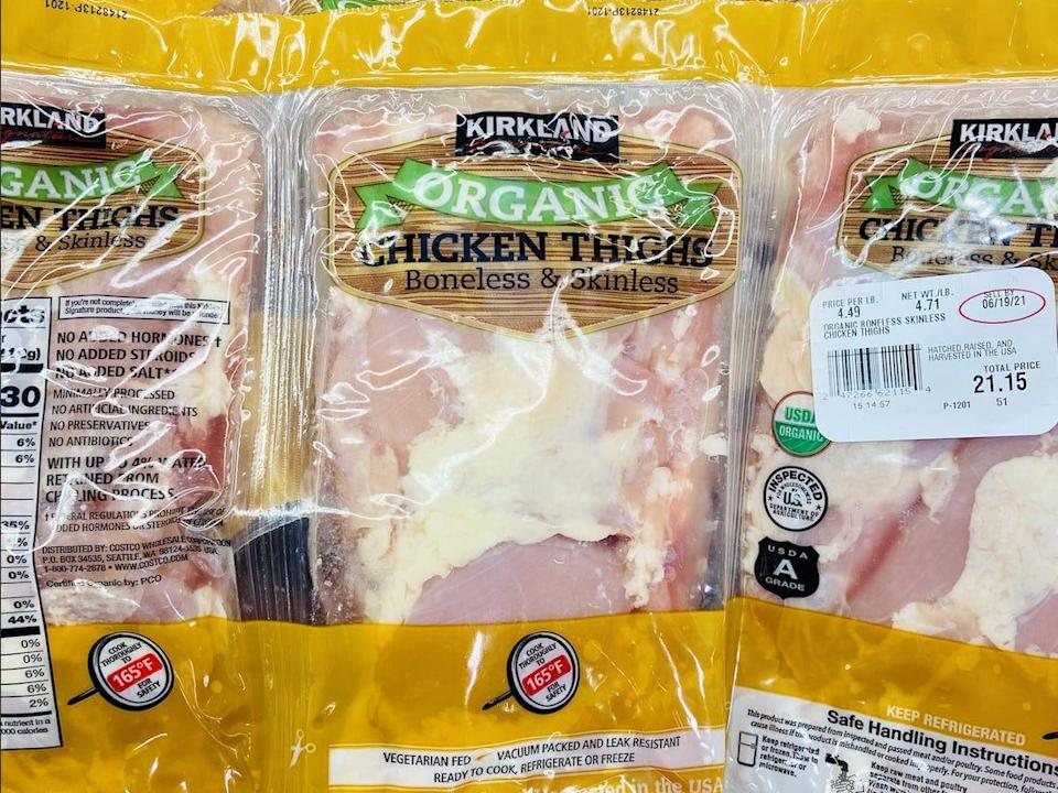 Yellow and clear packs of organic chicken thighs at costco