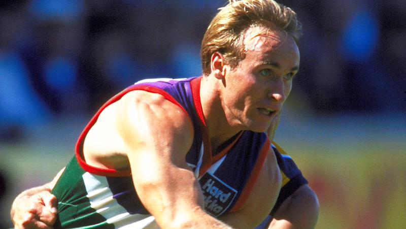 Quenton Leach, pictured here playing for Fremantle against West Coast in 1997.