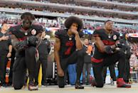 Eli Harold #58, Colin Kaepernick #7, and Eric Reid #35 of the San Francisco 49ers kneel in protest during the national anthem prior to their NFL game against the Arizona Cardinals at Levi's Stadium on October 6, 2016 in Santa Clara, California. (Photo by Thearon W. Henderson/Getty Images)