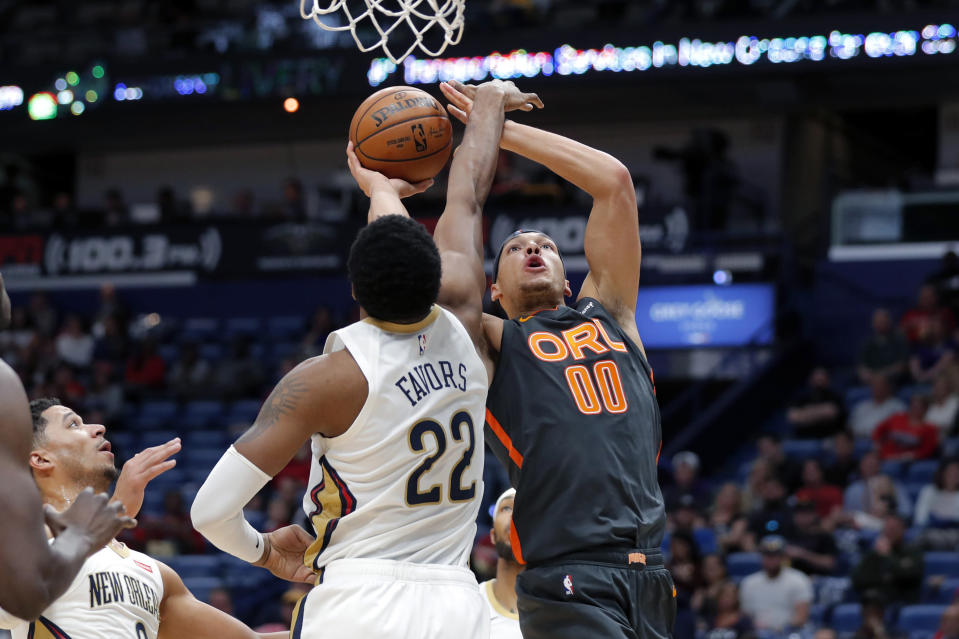 Orlando Magic forward Aaron Gordon (00) goes to the basket against New Orleans Pelicans forward Derrick Favors (22) in the first half of an NBA basketball game in New Orleans, Sunday, Dec. 15, 2019. (AP Photo/Gerald Herbert)