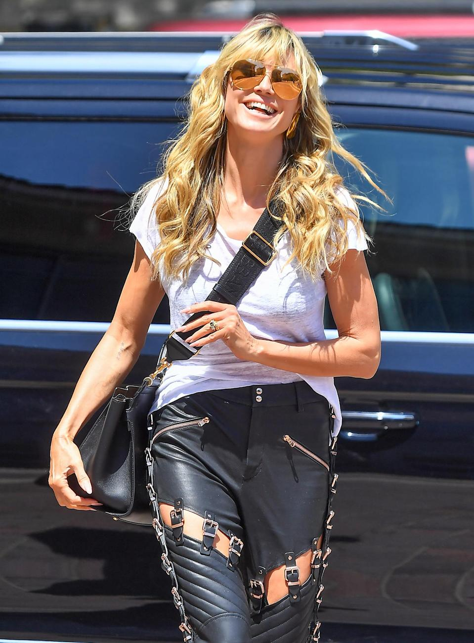 <p>Heidi Klum arrives at the <em>America's Got Talent</em> set in Pasadena on Friday.</p>