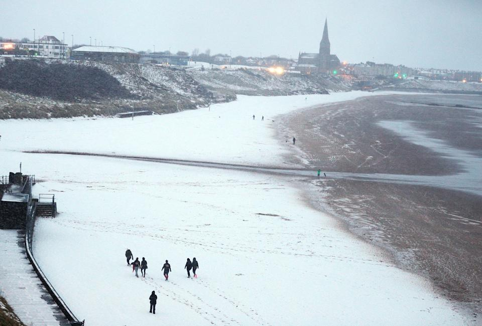 <p>A snowy Tynemouth beach, following heavy overnight snowfall on Monday night which has caused disruption across Britain. (PA) </p>
