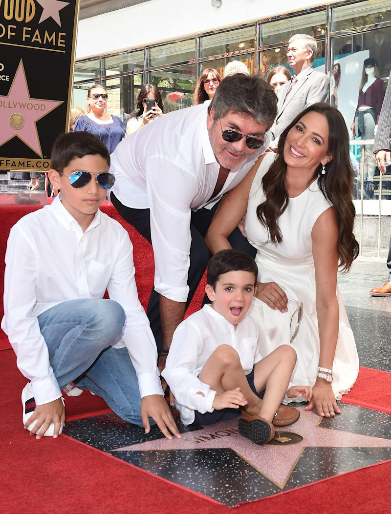 HOLLYWOOD, CA - AUGUST 22: Simon Cowell, Lauren Silverman, Eric Cowell and Adam Silverman attend the ceremony honoring Simon Cowell with star on the Hollywood Walk of Fame on August 22, 2018 in Hollywood, California. (Photo by Axelle/Bauer-Griffin/FilmMagic)