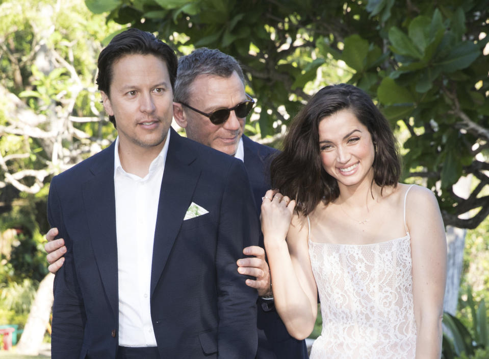 Director Cary Joji Fukunaga, from left, actors Daniel Craig and Ana de Armas pose for photographers during the photo call of the latest installment of the James Bond film franchise, currently known as 'Bond 25', in Oracabessa, Jamaica, Thursday, April 25, 2019. (AP Photo/Leo Hudson)