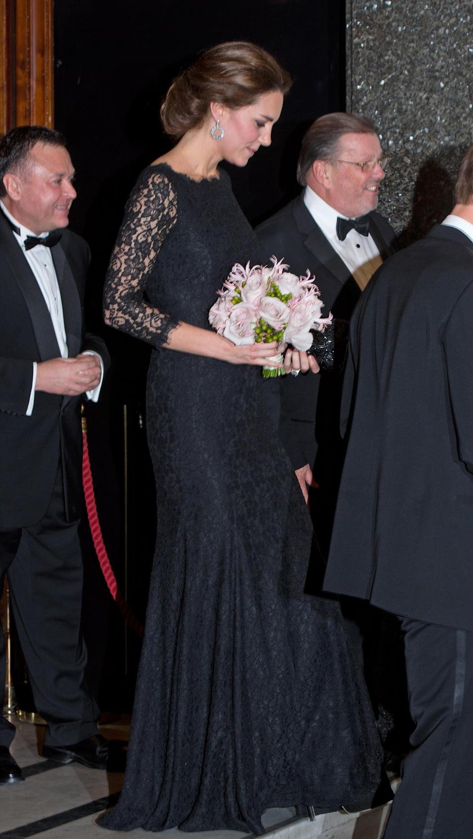 <p>The Duchess showed barely a hint of a bump in a black lacy design by Diane von Furstenberg. (Photo: PA) </p>