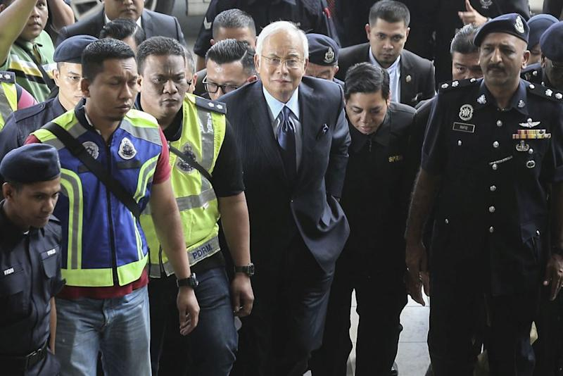 Malaysia ex-PM hit with 25 new charges over 1MDB scandal