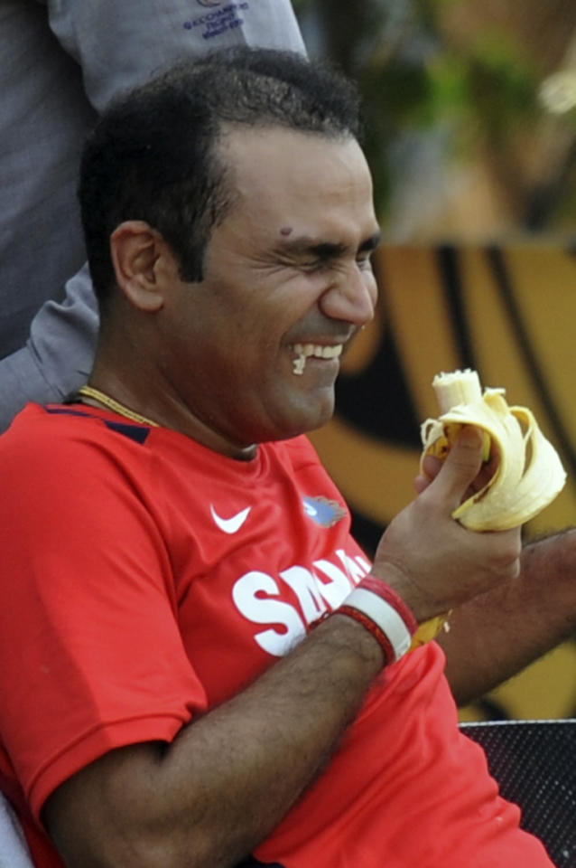 Indian cricketer Virender Sehwag reacts as teammate Sachin Tendulkar (unseen) jokes with him during a training session at The Punjab Cricket Associaton (PCA) Stadium in Mohali on March 28, 2011. India will face Pakistan in an ICC Cricket World Cup semi-final match at the stadium on March 30.  AFP PHOTO/Indranil MUKHERJEE (Photo credit should read INDRANIL MUKHERJEE/AFP/Getty Images)