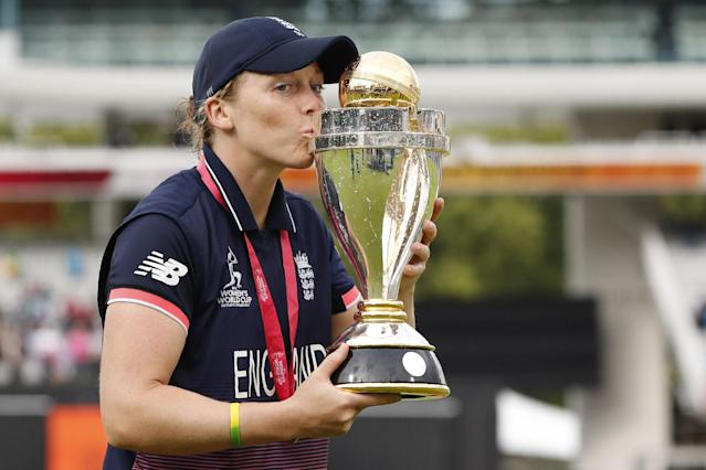 England captain Heather Knight poses with the trophy after winning the ICC Women's World Cup