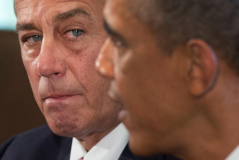 House Speaker John Boehner of Ohio listens as President Barack Obama speaks to media, in the Cabinet Room of the White House in Washington, Tuesday, Sept. 3, 2013, before a meeting with between the president and Congressional leaders to discuss the situation in Syria. Boehner said he will support the president's call for the U.S. to take action against Syria for alleged chemical weapons use and says his Republican colleagues should support the president, too. (AP Photo/Carolyn Kaster)