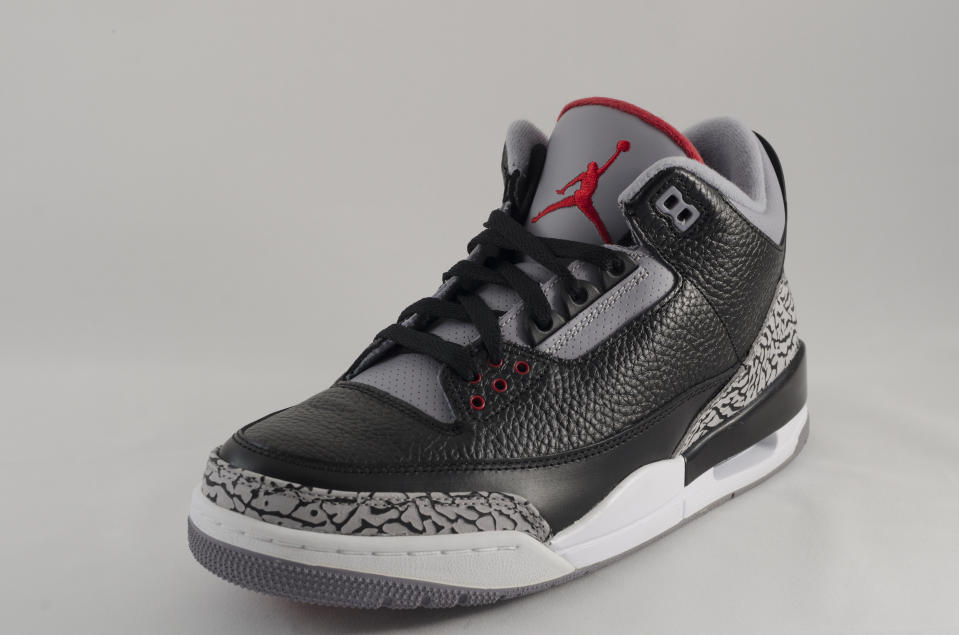 "Bergen County New Jersey, USA - September 8, 2013: A Nike Air Jordan III in a black and grey colorway. The Air Jordan 3 was a pivitol release in the Air Jordan sneaker legacy. Said to be Michael Jordan's favorite shoe, this design was the first to feature the ""Jumpman"" logo and influenced Jordan's decision to stay with Nike. Originally released in 1988, the Air Jordan III was re-released in 1999,2000,2004,2006,2008,and 2012"