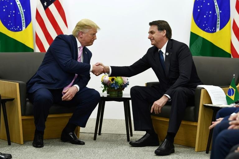 Brazil's President Jair Bolsonaro (R, pictured October 2019) says he has a direct line to US President Donald Trump -- which he may need if Washington reimposes tariffs on his country's steel and aluminum industries
