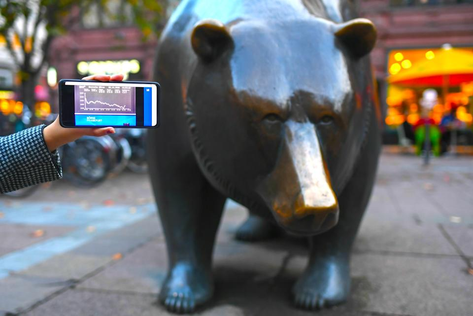 FRANKFURT, Oct. 28, 2020 -- Photo taken on Oct. 28, 2020 shows the DAX index on a mobile phone screen in front of the Bull and Bear sculptures outside the Frankfurt Stock Exchange in Frankfurt, Germany. German shares lost on Wednesday, with the benchmark DAX index down 503.06 points, or 4.17 percent, to close at 11,560.51 points. (Photo by Lu Yang/Xinhua via Getty) (Xinhua/Lu Yang via Getty Images)