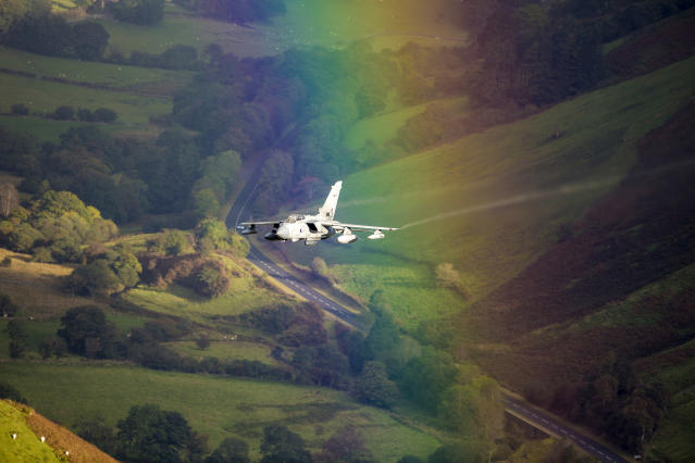 <p>A plane flies through a rainbow in Wales. (Photo: Caters News) </p>