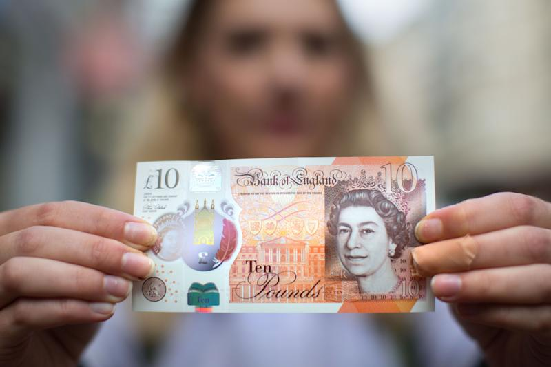 A woman holding a new ten pound note. Photo: Aaron Chown/PA Archive/PA Images
