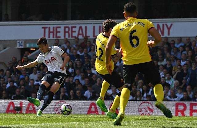 Tottenham Hotspur's Son Heung-Min (L) scores his team's fourth, and his second goal during their match against Watford at White Hart Lane in London, on April 8, 2017 (AFP Photo/Justin TALLIS)