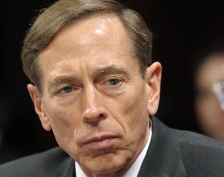 FILE - I this Feb. 2, 2012 file photo, then-CIA Director David Petraeus testifies on Capitol Hill in Washington. A request by a Swiss-born World War II hero spy to be buried at Arlington National Cemetery received a boost from Petraeus months before he resigned amid a sex scandal. (AP Photo/Cliff Owen, File)