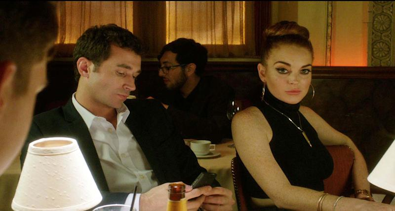 """This film image released by IFC Films shows Lindsay Lohan, right, and James Deen in a scene from """"The Canyons."""" (AP Photo/IFC Films)"""