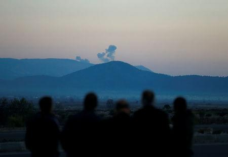 Smoke rises from the Syria's Afrin region, as it is pictured from near the Turkish town of Hassa, on the Turkish-Syrian border in Hatay province