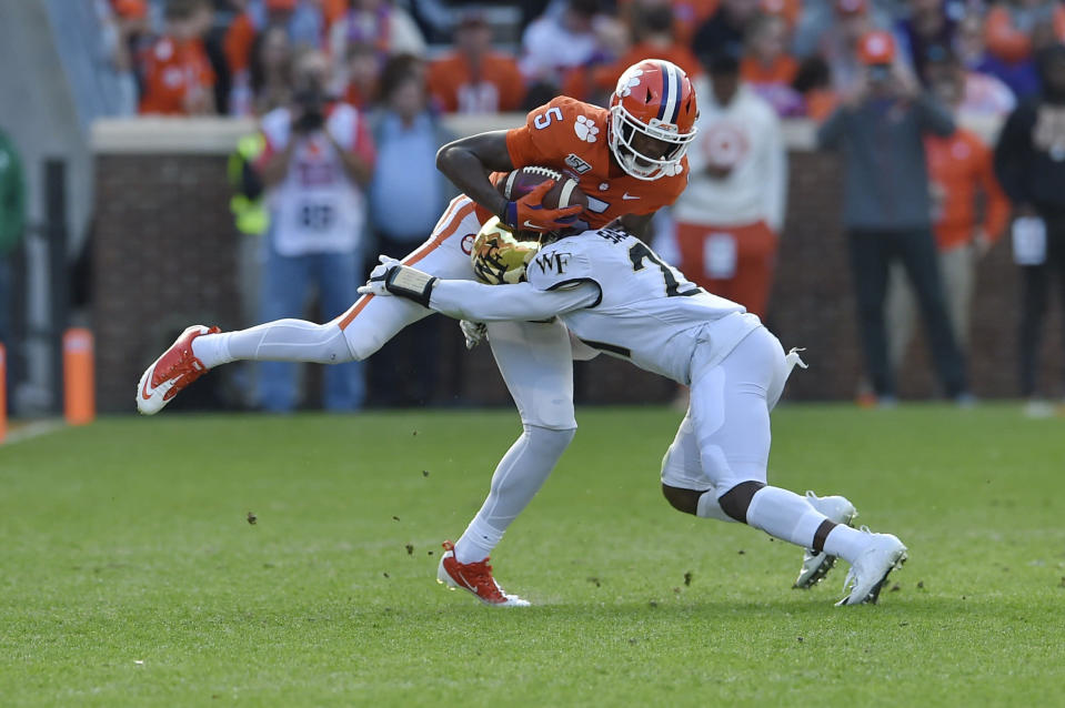 Clemson's Tee Higgins catches a pass while defended by Wake Forest's Essang Bassey (5) during the first half of an NCAA college football game Saturday, Nov. 16, 2019, in Clemson, S.C. (AP Photo/Richard Shiro)