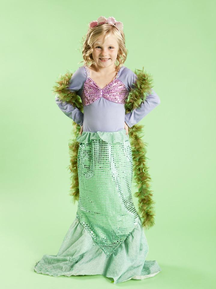 "<p>Admit it: There's a small part of you that secretly wishes you could be a mermaid, and we're thinking that your kids have daydreamed about the same exact thing ever since they saw <em><a href=""https://www.countryliving.com/life/entertainment/g25217168/best-classic-kids-movies/"">The Little Mermaid</a></em>. Between the seashell bling and sparkly fins, being a mermaid sounds pretty darn amazing. But since humans can't really breathe underwater, you and your <a href=""https://www.countryliving.com/diy-crafts/g1360/halloween-costumes-for-kids/"">little ones</a> will have to turn to the next best thing—<a href=""https://www.countryliving.com/diy-crafts/g21349110/best-friend-halloween-costumes/"">dressing up</a> as a mermaid for <a href=""https://www.countryliving.com/entertaining/a40250/heres-why-we-really-celebrate-halloween/"">Halloween</a>. With a little craftiness, you can easily make these DIY mermaid costume ideas come to life, well within your budget. All you'll need is some shimmering fabric, seashells, and of course, a glittering crown.</p><p> From <a href=""https://www.countryliving.com/diy-crafts/g4537/best-baby-halloween-costumes/"">babies</a> to <a href=""https://www.countryliving.com/diy-crafts/g4975/toddler-halloween-costume-ideas/"">toddlers</a> to <a href=""https://www.countryliving.com/diy-crafts/g22118522/teen-halloween-costumes/"">teens</a>, we have mermaid costumes covered for <a href=""https://www.countryliving.com/diy-crafts/g28181767/mom-halloween-costumes/"">your whole family</a>. And we didn't forget about you, beach babe! Discover how to make an <a href=""https://www.countryliving.com/diy-crafts/g28305469/diy-hippie-costume/"">adult version</a> of a mermaid Halloween costume and learn how to do some ocean-like makeup to match. We even covered <a href=""https://www.countryliving.com/diy-crafts/g4616/diy-halloween-costumes-for-couples/"">couples costume ideas</a> so you can <em>shell</em>-ibrate Halloween with your significant other. Also, if you'd prefer to skip the skirt or fins, we rounded up seafaring costume ideas that include comfy (and warm!) pants. To stand out and shine this Halloween, here are 18 DIY mermaid costumes that will inspire you to <em>seas</em> the day.</p>"