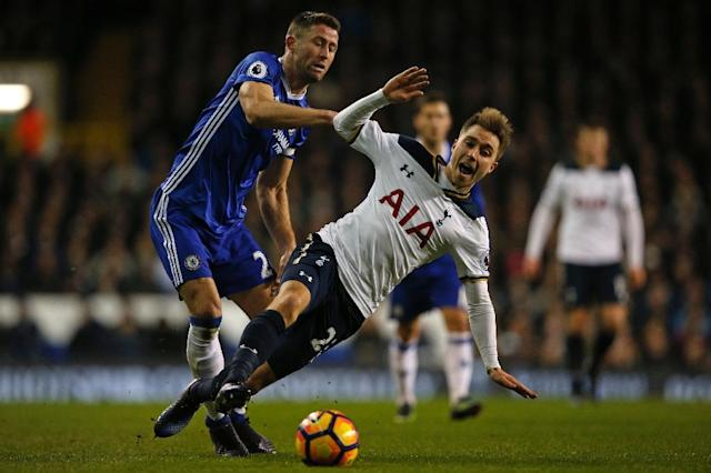 Tottenham Hotspur's midfielder Christian Eriksen is held back by Chelsea's defender Gary Cahill (L) during the English Premier League football match between Tottenham Hotspur and Chelsea at White Hart Lane in London, on January 4, 2017 (AFP Photo/Adrian DENNIS)