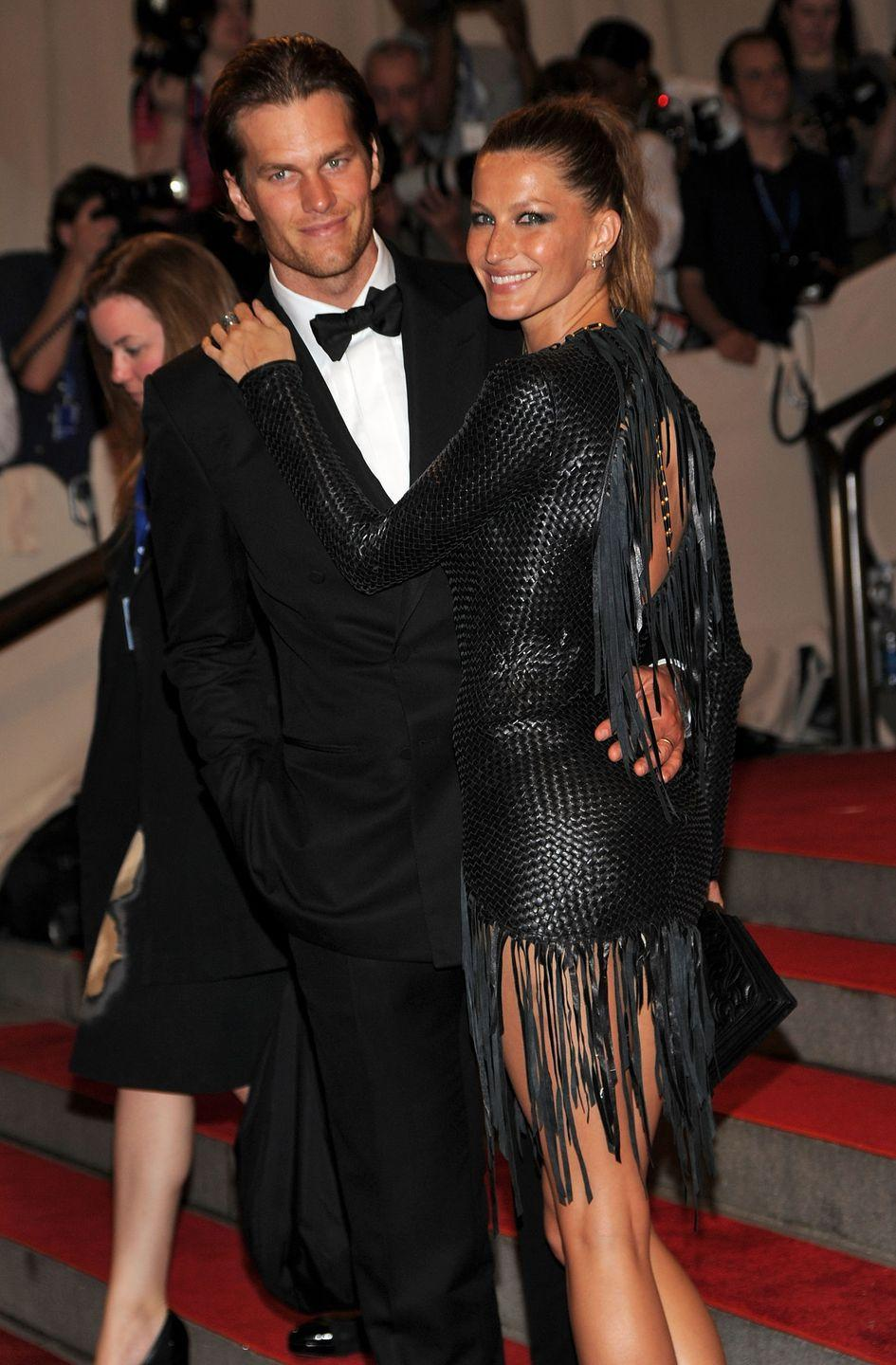 """<p>Tom Brady and Gisele Bündchen got married in a church ceremony with only their parents in attendance, which they followed with a home reception. """"We went back to the house and I barbecued aged New York strips. We had champagne, a cake, some ice cream. It was a great night. I think you always have this idea that weddings need to be 200 people and you invite everybody, and I'm all for it if people want to do that, but I think there was really something special about just having our parents there,"""" Tom told <a href=""""https://www.gq.com/story/tom-brady-nfl-patriots-gisele"""" rel=""""nofollow noopener"""" target=""""_blank"""" data-ylk=""""slk:GQ"""" class=""""link rapid-noclick-resp""""><em>GQ</em></a>. </p>"""