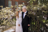 In this image released Sunday May 30, 2021, by Downing Street, Britain's Prime Minister Boris Johnson and Carrie Johnson pose together for a photo in the garden of 10 Downing Street after their wedding on Saturday. Boris Johnson and his fiancée Carrie Symonds are newlyweds, according to an announcement from his Downing Street office saying they were married Saturday in a small private ceremony in London. (Rebecca Fulton/Downing Street via AP)