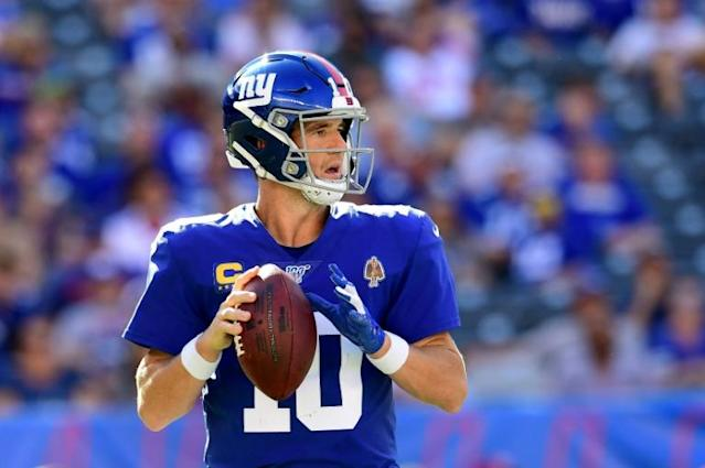 New York Giants quarterback Eli Manning has been relieved of his starting role after nearly 15 years (AFP Photo/Emilee Chinn)