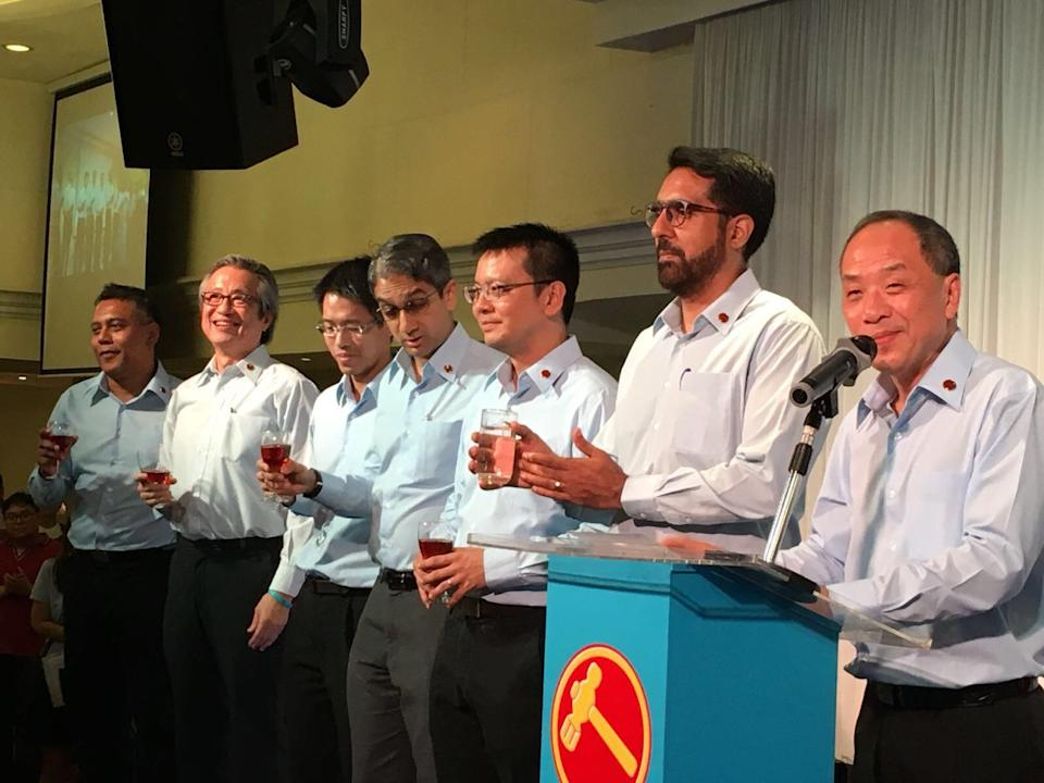 Workers' Party chief Low Thia Khiang (right) announced at WP's 60th anniversary celebratory dinner that he will step down from his post next year after the . Photo: Yahoo News Singapore/Nicholas Yong