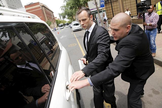 Oscar Pistorius (2nd R) leaves the North Gauteng High Court in Pretoria, South Africa after his bail hearing, December 8, 2015. REUTERS/Sydney Seshibedi