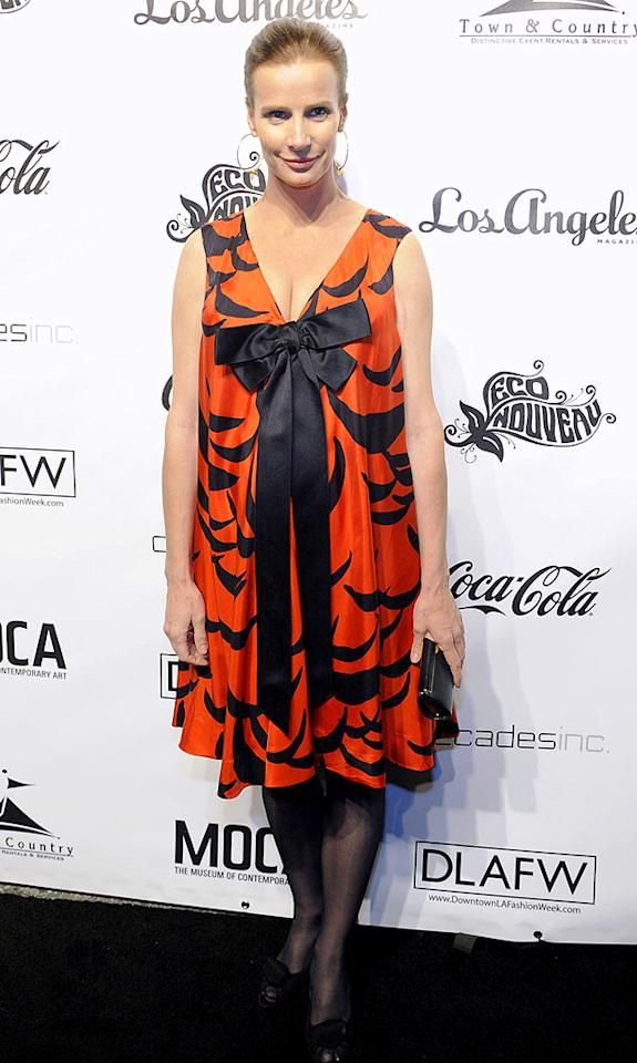 "Rachel Griffiths may be pregnant, but that's no excuse for covering her baby bump with this bowed bomb from Wilma Flintstone's closet. Arun Nevader/<a href=""http://www.wireimage.com"" target=""new"">WireImage.com</a> - March 19, 2009"
