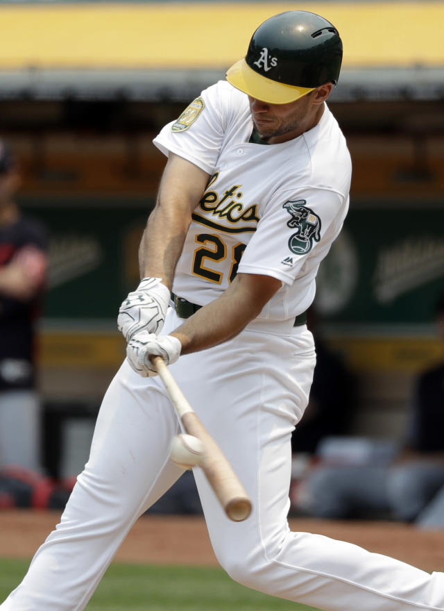 Oakland Athletics' Matt Olson drives in a run with a double during the fourth inning of a baseball game against the Cleveland Indians, Sunday, July 1, 2018, in Oakland, Calif. (AP Photo/Marcio Jose Sanchez)