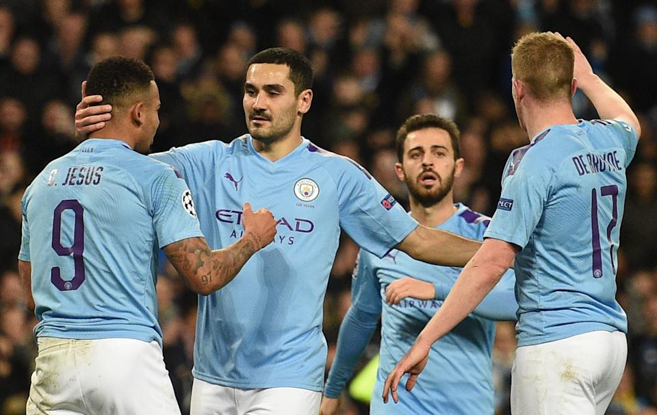 Manchester City's German midfielder Ilkay Gundogan (2L) celebrates scoring the opening goal during the UEFA Champions League football Group C match between Manchester City and Shakhtar Donetsk at the Etihad Stadium in Manchester, north west England on November 26, 2019. (Photo by Oli SCARFF / AFP) (Photo by OLI SCARFF/AFP via Getty Images)